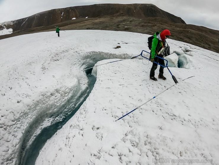 Latvijas Universitātes zinātnieki atgriezušies no ekspedīcijas Svalbāras arhipelāgā, kur tie pētīja ledājus un vides piesārņojumu vietā, kuru no Zieme 263887